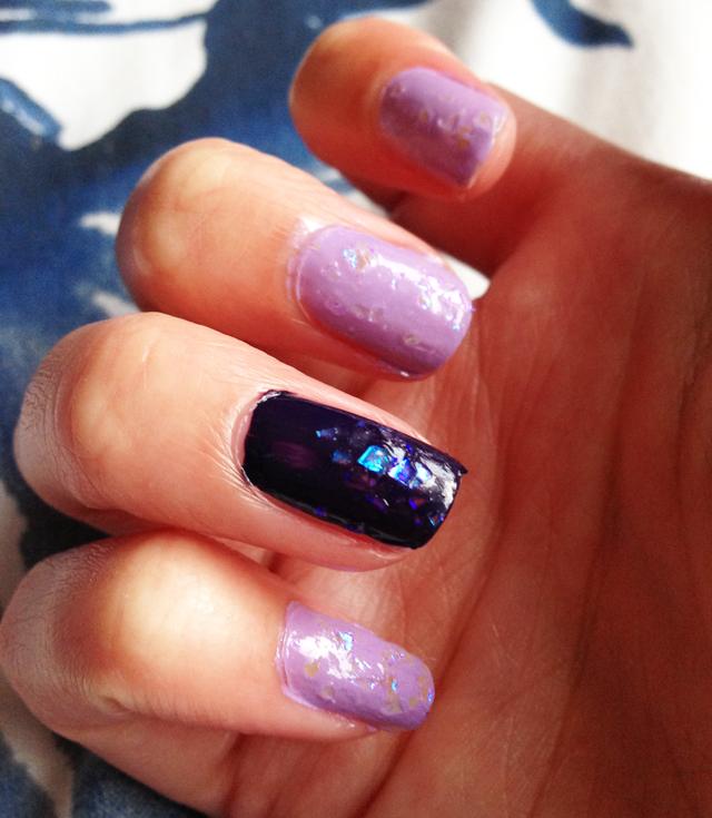 lilac and dark purple glittler nail varnish