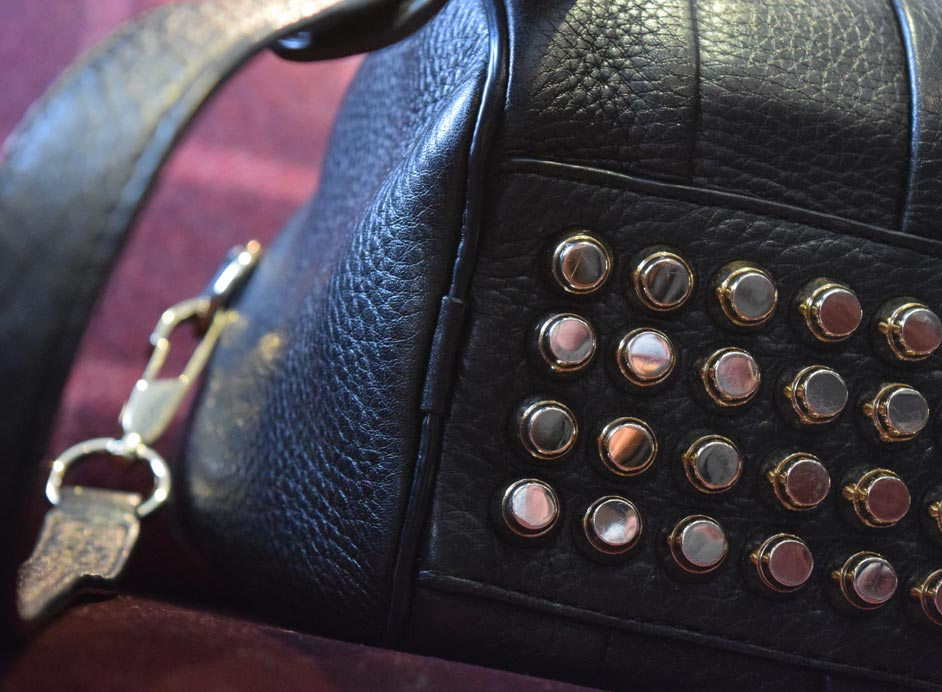 Rockie gold studded designer hand bag by Alexander Wang